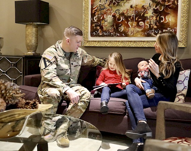 """Army Lt. Col. Patrick """"Pat"""" Miller and his family visit the Madigan Army Medical Center Fisher House at Joint Base Lewis-McChord. Pat's family stayed at the Fort Hood Carl R. Darnall Army Medical Center Fisher House when Pat was shot during an active shooter situation on the base."""